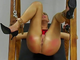 Gorgeous busty babe being spanked with power