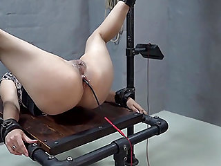 Slave girl Aijana gets fucked by a machine
