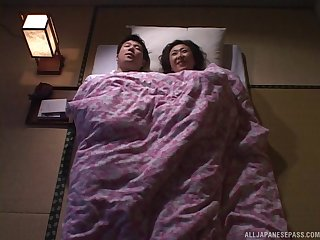 Asian MILF crawls into bed and and gets her tight pussy fucked